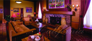 hotel lobby interior with fireplace and chairs