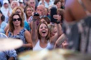 Happy girl at Rock the Block with group of people